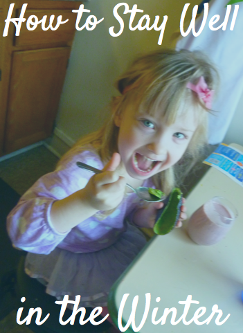 My daughter eating her avocado and drinking her smoothie to stay healthy!